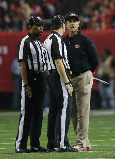 San Francisco 49ers head coach Jim Harbaugh argues a call during the first half of the NFL football NFC Championship game against the Atlanta Falcons Sunday, Jan. 20, 2013, in Atlanta. (AP Photo/Dave Martin)