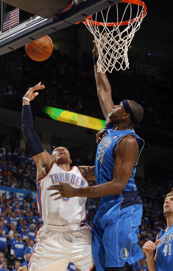 Oklahoma City's Russell Westbrook (0) shoots as Brendan Haywood (33) of Dallas defends during game 3 of the Western Conference Finals of the NBA basketball playoffs between the Dallas Mavericks and the Oklahoma City Thunder at the OKC Arena in downtown Oklahoma City, Saturday, May 21, 2011. Photo by Sarah Phipps, The Oklahoman