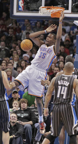 Oklahoma City Thunder's Kevin Durant (35) scores on a dunk in the first half as the Oklahoma City Thunder play the Orlando Magic in NBA basketball at the Chesapeake Energy Arena on Sunday, Dec. 25, 2011, in Oklahoma City, Okla.  Photo by Steve Sisney, The Oklahoman