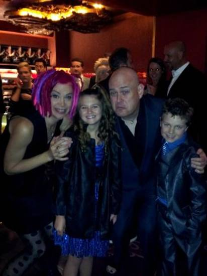 "Oklahoma child actors Raevan Lee Hanan, 10, and her brother Korbyn Hawk Hanan, 8, pose with ""Cloud Atlas"" co-writer/directors Lana and Andy Wachowski at the film's Los Angeles premiere. Photo provided."