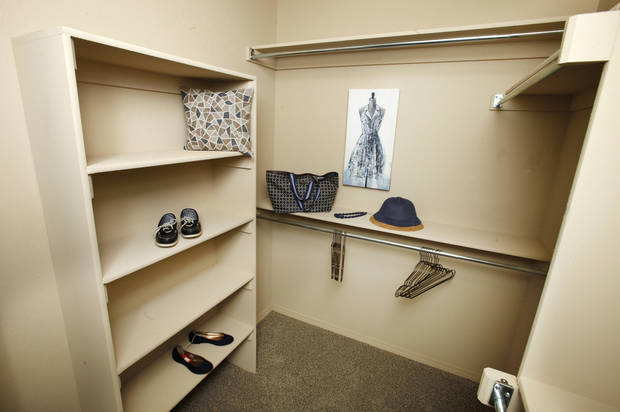 Built-ins add extra functionality to the master bedroom closet at the Ideal Homes model at 11424 NW 131. <strong>PAUL B. SOUTHERLAND - The Oklahoman</strong>