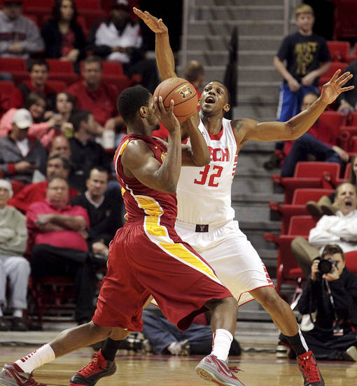 Iowa State's Melvin Ejim is defended by Texas Tech's Jordan Tolbert (32) during their NCAA college basketball game, Wednesday, Jan. 23, 2013, in Lubbock, Texas. (AP Photo/The Avalanche-Journal, Stephen Spillman) ALL LOCAL TV OUT