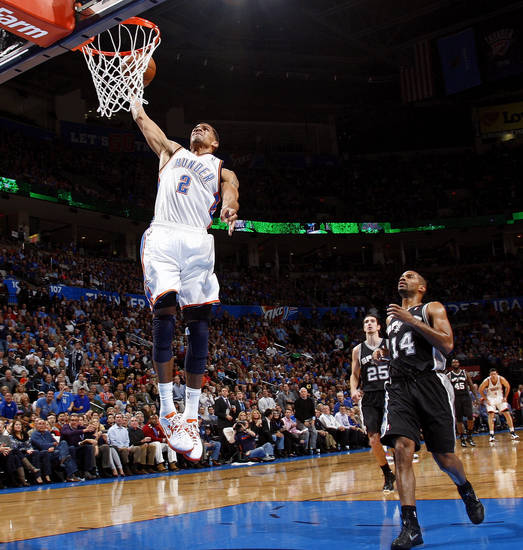 Oklahoma City&#039;s Thabo Sefolosha (2) dunks the ball in front of San Antonio&#039;s Gary Neal (14) and Nando de Colo (25) during an NBA basketball game between the Oklahoma City Thunder and the San Antonio Spurs in Oklahoma City Monday, Dec. 17, 2012. Oklahoma City won, 107-93. Photo by Nate Billings, The Oklahoman