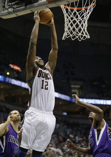 Milwaukee Bucks' Luc Richard Mbah a Moute (12) dunks the ball against Sacramento Kings during the second half of an NBA basketball game on Wednesday, Dec. 12, 2012, in Milwaukee. (AP Photo/Jeffrey Phelps)