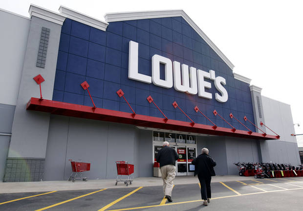FILE -- In a Nov. 14, 2011 file photo, customers walk toward the Lowe's store in Saugus, Mass. Lowe's Cos.'reported Monday May 21, 2012, first-quarter profit climbed 14 percent, as warmer weather helped boost sales. (AP Photo/Michael Dwyer/file)