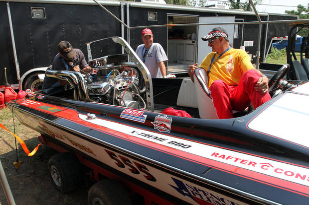 """Sotally Tober"" crew members, left to right. Jason Gothard, Tracy Walls and driver Steve Walls prepare their boat for the Ozarka Oklahoma City Nationals Drag Boat races on the Oklahoma river Sunday, June 10th, 2012. PHOTO BY HUGH SCOTT, FOR THE OKLAHOMAN"