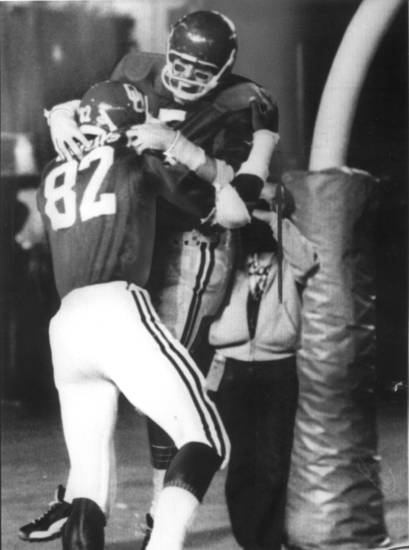 COLLEGE FOOTBALL: 1976 ORANGE BOWL - A HAPPY BILLY BROOKS AND STEVE DAVIS CELEBRATE AFTER FIRST OU TOUCHDOWN