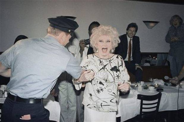 Phyllis Diller at her 70th birthday party on July 16, 1987 at Giancarlo restaurant on 3rd Ave near 78 Street in New York. Diller clowns with unidentified man in uniform at her party. (AP Photo/ David Bookstaver)