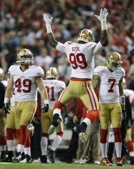 San Francisco 49ers' Aldon Smith reacts after recovering a fumble during the second half of the NFL football NFC Championship game against the Atlanta Falcons Sunday, Jan. 20, 2013, in Atlanta. (AP Photo/David Goldman)