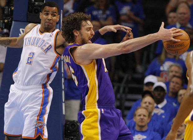 Los Angeles' Pau Gasol (16) grabs the ball in front of Oklahoma City's Thabo Sefolosha (2) during Game 5 in the second round of the NBA playoffs between the Oklahoma City Thunder and the L.A. Lakers at Chesapeake Energy Arena in Oklahoma City, Monday, May 21, 2012. Photo by Bryan Terry, The Oklahoman
