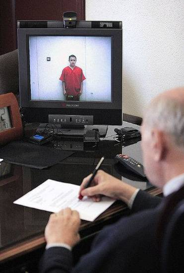 Tristan Owen, 15, appears from the Oklahoma County Jail in a monitor during his video arraignment in the chamber of Special Judge Russell Hall at the Oklahoma County Courthouse in Oklahoma City Friday, July 15, 2011. Photo by Paul B. Southerland, The Oklahoman ORG XMIT: KOD