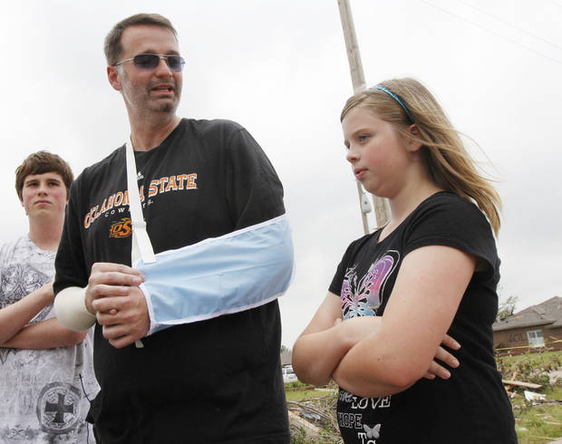 Jeff Wilhelm and his daughter Lauryn tell about Lauryn's escape from the rubble of Briarwood Elementary School after the May 20 tornado in Moore. Wilhelm broke both arms pulling kids out of the  destroyed school. PHOTO BY PAUL HELLSTERN, THE OKLAHOMAN <strong>PAUL HELLSTERN - Oklahoman</strong>