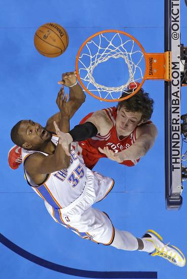 Oklahoma City's Kevin Durant (35) battles under the basket with Houston's Omer Asik (3) during Game 2 in the first round of the NBA playoffs between the Oklahoma City Thunder and the Houston Rockets at Chesapeake Energy Arena in Oklahoma City, Wednesday, April 24, 2013. Photo by Chris Landsberger, The Oklahoman