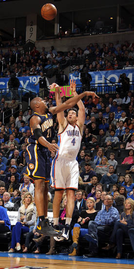 Oklahoma City's Nick Collison (4) shoots as Indiana's David West (21) defends 