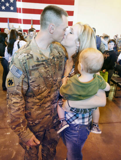 Shelly Mantooth and 18 month old Collin  greet husband and father Spc. Jason Mantooth, as Oklahoma National Guard soldiers return from Afghanistan to a welcome home ceremony in Oklahoma City, OK, Tuesday, March 13, 2012,  By Paul Hellstern, The Oklahoman