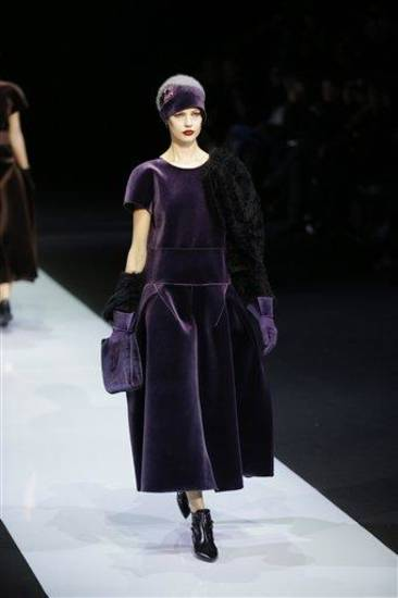 A model wears a creation for Emporio Armani women&#039;s Fall-Winter 2013-14 collection, part of the Milan Fashion Week, unveiled in Milan, Italy, Sunday, Feb. 24, 2013. (AP Photo/Luca Bruno)