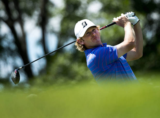 Brandt Snedeker, of the United States, watches his tee shot on the third hole during the final round of play at Glen Abbey at the Canadian Open golf tournament in Oakville, Ontario, Sunday, July 28, 2013. (AP Photo/The Canadian Press, Nathan Denette)