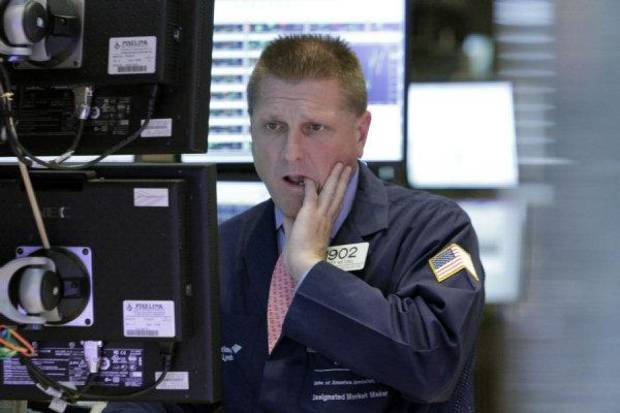 Specialist Scott Wetzel works on the floor of the New York Stock Exchange Tuesday. A wave of selling is sweeping across Wall Street and stock markets around the world after Greece's prime minister said he would call a national vote on an unpopular European plan to rescue that nation's economy. AP Photo <strong>Richard Drew</strong>