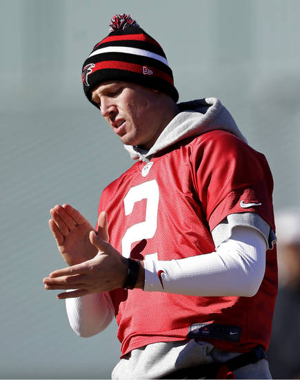 Atlanta Falcons' Matt Ryan walks on the field during NFL football practice at the team's training facility, Friday, Jan. 18, 2013, in Flowery Branch, Ga. The Falcons host the San Francisco 49ers in the NFC championship on Sunday. (AP Photo/David Goldman)