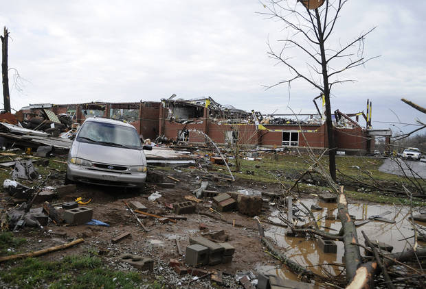 Debris litters the front of the Henryville Middle School which received extensive damage from storms that rolled through the area Friday, March 2, 2012, in Henryville, Ind. Tornadoes ripped across several small southern Indiana towns on Friday, killing at least three people and leaving behind miles of flattened devastation along the border with Kentucky. (AP Photo/Timothy D. Easley) ORG XMIT: KYTE102