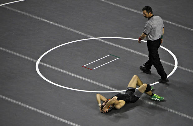 Matt Shepard of Catoosa reacts after a first round loss to Tuttle's Isaac Beard in the in Class 4A 145 pound match during the 90th annual Oklahoma High School state wrestling tournament on Friday, Feb. 25, 2011, in Oklahoma City, Okla.  Photo by Chris Landsberger, The Oklahoman