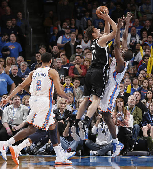 Oklahoma City's Serge Ibaka (9) tries to stop Brooklyn Nets' Brook Lopez (11) during the NBA basketball game between the Oklahoma City Thunder and the Brooklyn Nets at the Chesapeake Energy Arena on Wednesday, Jan. 2, 2013, in Oklahoma City, Okla. Photo by Chris Landsberger, The Oklahoman