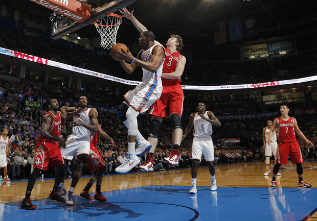 Oklahoma City 's Kevin Durant (35) drives to the basket past Houston's Omer Asik (3) during the NBA basketball game between the Houston Rockets and the Oklahoma City Thunder at the Chesapeake Energy Arena on Wednesday, Nov. 28, 2012, in Oklahoma City, Okla.   Photo by Chris Landsberger, The Oklahoman