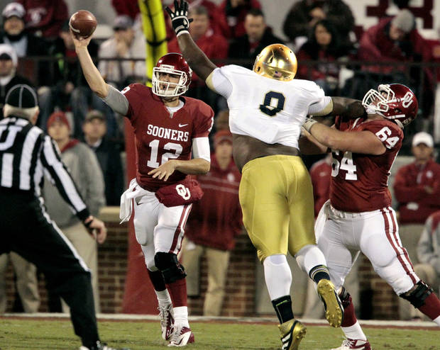 Oklahoma quarterback Landry Jones (12) throws during the first half of the college football game between the University of Oklahoma Sooners (OU) and the Fighting Irish of Notre Dame (ND) at Gaylord Family-Oklahoma Memorial Stadium in Norman, Okla., on Saturday, Oct. 27, 2012. Photo by Steve Sisney, The Oklahoman