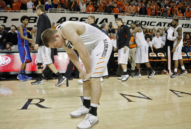Oklahoma State 's Phil Forte (13) reacts after the 68-67 double overtime loss to Kansas during the college basketball game between the Oklahoma State University Cowboys (OSU) and the University of Kanas Jayhawks (KU) at Gallagher-Iba Arena on Wednesday, Feb. 20, 2013, in Stillwater, Okla. Photo by Chris Landsberger, The Oklahoman