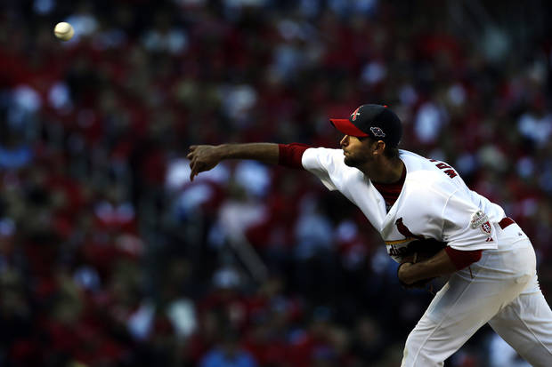 St. Louis Cardinals starting pitcher Adam Wainwright throws during the fifth inning in Game 1 of baseball's National League division series against the Washington Nationals, Sunday, Oct. 7, 2012, in St. Louis. (AP Photo/Jeff Roberson)