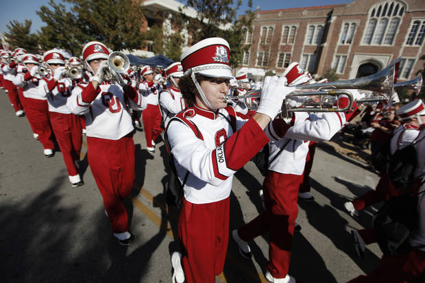 OU: Bennett Oden plays trumpet with the Pride of Oklahoma Marching Band during the University of Oklahoma Homecoming Parade in Norman, Okla., Saturday, Oct. 20, 2012.  Photo by Garett Fisbeck, The Oklahoman