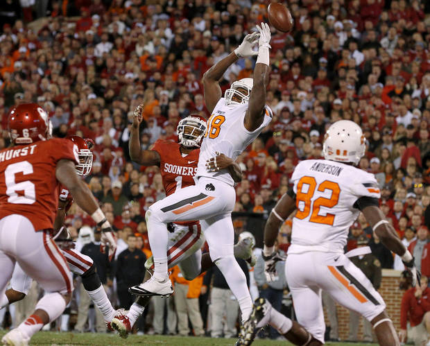 Oklahoma State's Blake Jackson (18) can't hold onto the pas as Oklahoma's Tony Jefferson (1) defends in overtime of  the Bedlam college football game between the University of Oklahoma Sooners (OU) and the Oklahoma State University Cowboys (OSU) at Gaylord Family-Oklahoma Memorial Stadium in Norman, Okla., Saturday, Nov. 24, 2012. Oklahoma won 51-48. Photo by Bryan Terry, The Oklahoman
