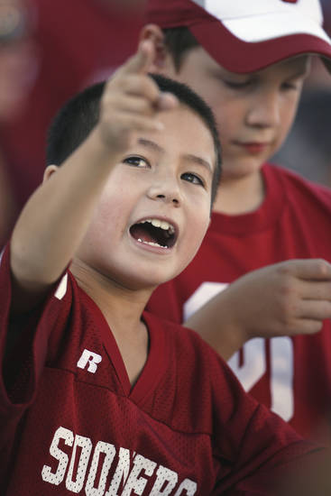 Ethan Bui, 8, of Edmond watched the college football game between the University of Oklahoma Sooners (OU) and Utah State University Aggies (USU) at the Gaylord Family-Oklahoma Memorial Stadium on Saturday, Sept. 4, 2010, in Norman, Okla.   Photo by Steve Sisney, The Oklahoman