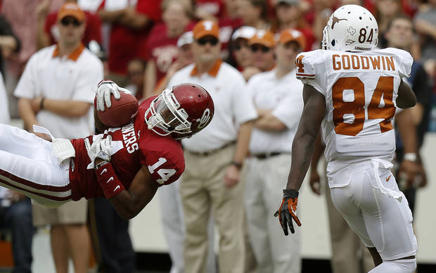 OU's Aaron Colvin (14) intercepts pass intended for UT's Marquise Goodwin (84) during the Red River Rivalry college football game between the University of Oklahoma (OU) and the University of Texas (UT) at the Cotton Bowl in Dallas, Saturday, Oct. 13, 2012. Photo by Bryan Terry, The Oklahoman