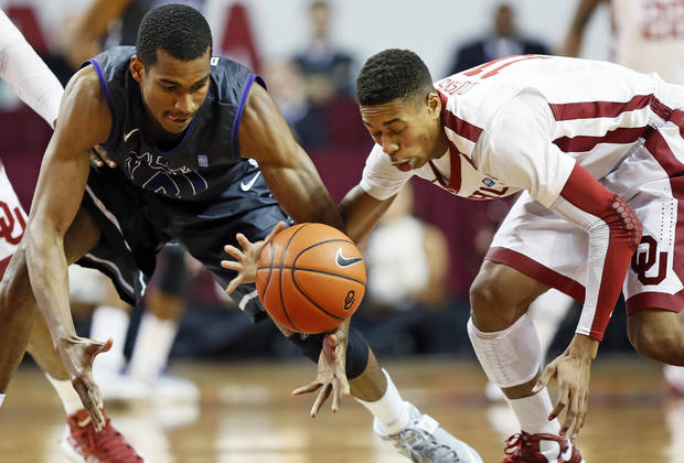 TCU's Nate Butler Lind (21) and Oklahoma's Isaiah Cousins (11) chase a loose ball during an NCAA men's basketball game between the University of Oklahoma (OU) and Texas Christian University (TCU) at the Lloyd Noble Center in Norman, Okla., Monday, Feb. 11, 2013. Photo by Nate Billings, The Oklahoman