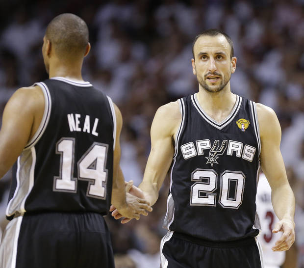 San Antonio Spurs shooting guard Manu Ginobili (20) and San Antonio Spurs point guard Gary Neal (14) react after second half of Game 1 of the NBA Finals basketball game against the Miami Heat, Thursday, June 6, 2013 in Miami. (AP Photo/Lynne Sladky) ORG XMIT: AAA168