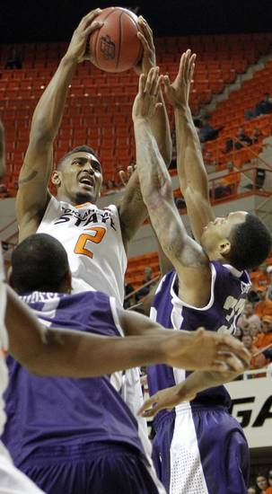 Oklahoma State's Le'Bryan Nash (2) shoots over TCU's Garlon Green (33) during the college basketball game between Oklahoma State University Cowboys (OSU) and Texas Christian University Horned Frogs (TCU) at Gallagher-Iba Arena on Wednesday Jan. 9, 2013, in Stillwater, Okla. 