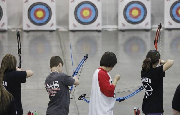 Students take aim during the State Archery Tournament at the Cox Convention Center in Oklahoma City, Oklahoma March 31 , 2010. Photo by Steve Gooch, The Oklahoman