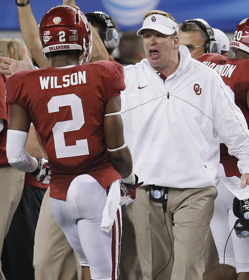 Mike Stoops yells at Oklahoma&#039;s Julian Wilson (2) during the college football Cotton Bowl game between the University of Oklahoma Sooners (OU) and Texas A&amp;M University Aggies (TXAM) at Cowboy&#039;s Stadium on Friday Jan. 4, 2013, in Arlington, Tx. Photo by Chris Landsberger, The Oklahoman