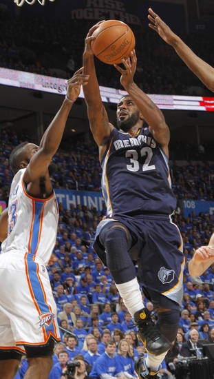 Memphis&#039; O.J. Mayo (32) drives to the basket past Oklahoma City&#039;s James Harden (13) during game one of the Western Conference semifinals between the Memphis Grizzlies and the Oklahoma City Thunder in the NBA basketball playoffs at Oklahoma City Arena in Oklahoma City, Sunday, May 1, 2011. Photo by Chris Landsberger, The Oklahoman