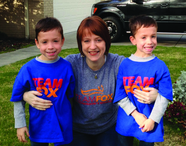 Nicole Jarvis poses with her twin 6-year-old sons, Zachary (left) and Ryan, in their Team Fox shirts. Photo provided. <strong></strong>