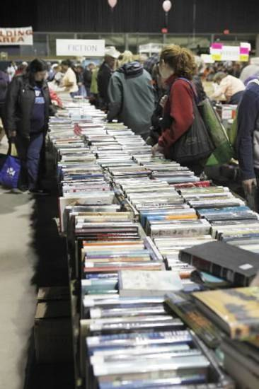 Crowds peruse the vast selection Saturday during the 32nd Annual Friends of the Library Booksale at State Fair Park in Oklahoma City. Photo by Paul Hellstern, The Oklahoman Archive