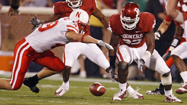 Oklahoma's Keenan  Clayton (22) goes after a fumble he forced on Nebraska's Dreu Young (49) during the first half of the college football game between the University of Oklahoma Sooners (OU) and the University of Nebraska Huskers (NU) at the Gaylord Family-Oklahoma Memorial Stadium, on Saturday, Nov. 1, 2008, in Norman, Okla. BY NATE BILLINGS, THE OKLAHOMAN