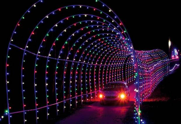Visitors to Santa Claus Land of Lights drive through an illuminated tunnel. PHOTO PROVIDED BY LAKE RUDOLPH CAMPGROUND AND RV RESORT. <strong></strong>