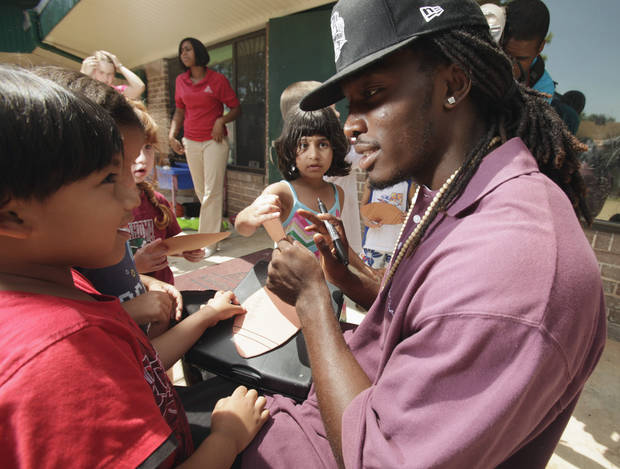 University of Oklahoma (OU) defensive back Quinton Carter signs autographs as he helps out with a tutoring/mentoring session at Kinder Care on Wednesday, June 30, 2010, in Norman Okla.   Carter is giving back -- in a big way. Even though he's still in college, he has already started a charitable foundation and is heavily involved in projects in Norman and in his hometown of Las Vegas. Photo by Steve Sisney, The Oklahoman