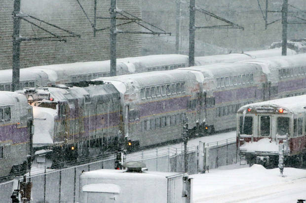 Massachusetts Bay Transportation Authority trains sit idle early Saturday, Feb. 9, 2013 in Boston due to high winds and the nearly two-feet of snow that fell in the area overnight. (AP Photo/Gene J. Puskar)