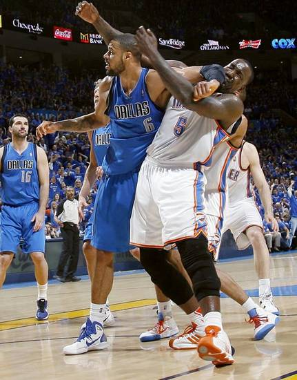 Tyson Chandler (6) of Dallas, gets an elbow in Kendrick Perkins' face and is called for a technical foul during game 4 of the Western Conference Finals in the NBA basketball playoffs between the Dallas Mavericks and the Oklahoma City Thunder at the Oklahoma City Arena in downtown Oklahoma City, Monday, May 23, 2011. The Thunder lost game 3 to the Mavericks 112-105. Photo by John Clanton, The Oklahoman ORG XMIT: KOD