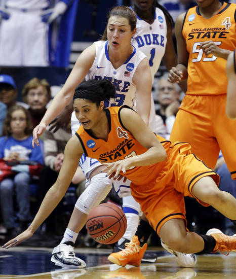 Duke's Haley Peters, rear, guards Oklahoma State's Brittney Martin during the first half of a second-round game in the women's NCAA college basketball tournament in Durham, N.C., Tuesday, March 26, 2013. (AP Photo/Gerry Broome)