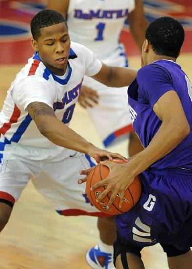DeMatha junior Jairus Lyles, left, tries to steal the ball from Gonzaga's Nate Britt.  Toni L. Sandys / The Washington Post
