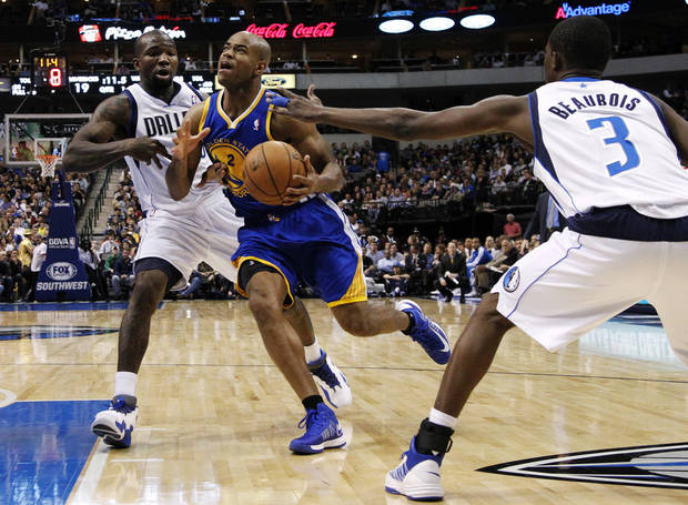 Dallas Mavericks' Dominique Jones (20) and Rodrigue Beaubois (3) defend against Golden State Warriors point guard Jarrett Jack (2) in the first half of an NBA basketball game, Monday, Nov. 19, 2012, in Dallas. (AP Photo/Tony Gutierrez)